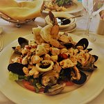 Prawns, clams,mussels, scallops, assorted fish on bed of lettuce & tomato