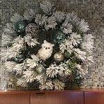 A Christmas wreath decor on the lobby wall