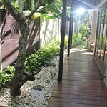Pathway from separate 'grannyflat' master round to main villa and pool contained in backyard