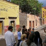 Instituto Habla Hispana students getting history lesson outside the Manantial