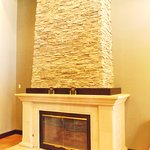 Lovely large fireplace in lobby area