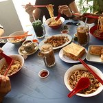 The spread of food we ordered: thick toast, carrot cake and Sarawak laksa!