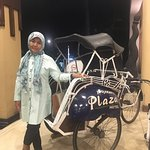 Posing in front of becak, traditional transportation in Jogjakarta