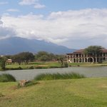 9th Hole with Club House and Mount Meru as a backdrop