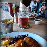 Proper pub grub prepared by the singing chef and served with a smile.