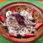 Fruit bowl with granola, seeds and yogurt