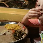My daughter, trying her first ethiopian food at Addis.