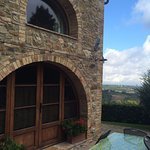 Podere Monti, Cottage Olivo front door with view to Tuscan countryside.