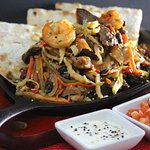 Korean Kimchee Dragon Fajitas ~ fresh mu shu tortillas, avocado, yuzu, sour cream, marinated tom