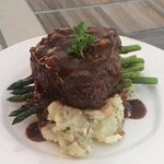 9oz Center Cut Filet Mignon over Parmesan Smashed Potatoes Asparagus and Bacon Demi.