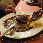 Steak and potato with black peppercorn sauce. Ask for the fried potatos instead. Delicious