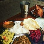 Home style South Indian thali curries served daily. GF. Vegan options.