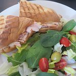 Turkey panini with melted smoked gouda and a side salad