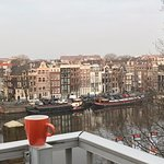 morning coffee on balcony over Amstel