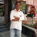 Mr.Venu Pillai --+919283798240--Organises rooms and facilities for you here as VHP volunteer