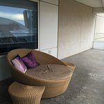 Large outdoor balcony with chaise