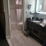 Pictures of a room with two queen beds. I took these photos to showcase the modern bathroom/vani