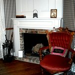 Fireplace in the bedroom of the Sherlock Holmes Suite
