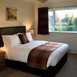 King sized double, first floor room with en-suite bath and walk in shower.