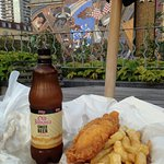 Fish and chips on the Terrace overlooking the Cable Street Riot mural