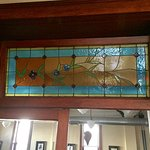 Original stained glass window over The Fred Restaurant entry