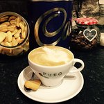 A beautiful latte with our free home made biscuits.