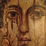 Wax encaustic mummy portrait of a young woman with gold jewelry named Isarous from Hawara, Egypt