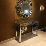 Mirroed consol table in hallway