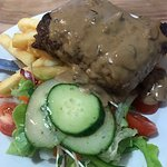 Garlic bread with melted cheese and 400gm New York Cut Steak with mushroom sauce, salad and chip