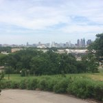 view of downtown Dallas while walking to the pool