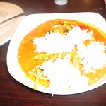 Red Curry with rice on top