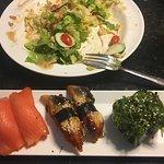 Smoked salmon, unagi & seaweed salad nigiri with green salad remnants in the background--at $6.9