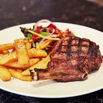 500g King Rib Eye Steak CharGrilled served with chips and salad