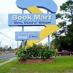 """Housed in an old Florida """"Googie"""" style motel, the Book Mart utilizes the old motel sign, sans n"""