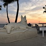 Sand sculpture of our dogs that was by the beach and poolside bar