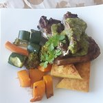 lamb chops with chimichurri sauce served with grilled polenta & vegetables