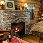 Paul Bunyan log cabin with whirlpool, fireplace, stove, refrigerator, coffee maker, microwave