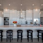 Fully furnished homes include kitchens - this one is custom, featuring Wolf ranges & wine fridge