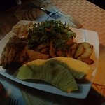 Fried flying fish, season fries, salad, macaroni salad and breadfruit