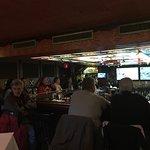 Full bar watching the football playoffs