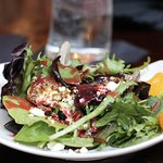 Field greens with mandarin oranges, candied pecans, feta cheese with raspberry vinaigrette
