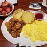 eggs, potatoes, english muffin and fruit
