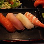 4 pieces of nigiri sushi - salmon, tuna, tai and ebi