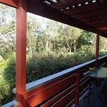 Large wrap-around balcony with tables & chairs
