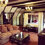Sitting area and four-poster bed in the Forest Suite
