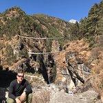 Trekking through Sagarmatha National Park toward Mount Everest. Hillary Bridge in the background