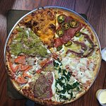 Order a Hideaway Super Special in which every slice contains two different toppings!