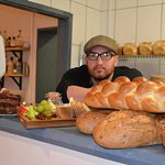 Owner Craig Poynter with bread and our cheese board