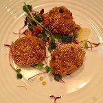 Vegan Starter: Smoked aubergine, mint and chilli arancini with roast lemon and Harissa dressing