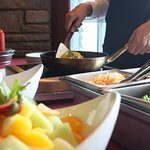 Complimentary Hot Breakfast Buffet with attended omelet station